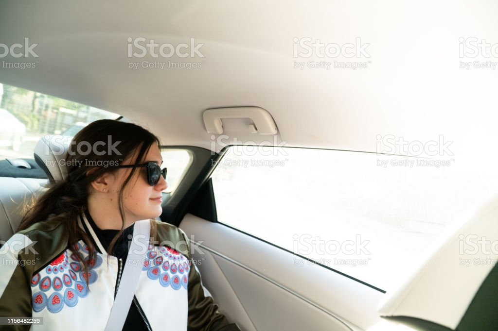 Fantastic Teenage Girl Daydreams Out Of The Window From The Back Seat Pabps2019 Chair Design Images Pabps2019Com