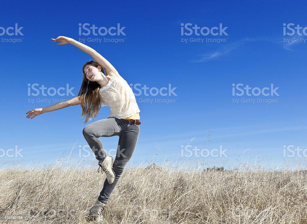 teenage girl doing gymnastics outdoors royalty-free stock photo