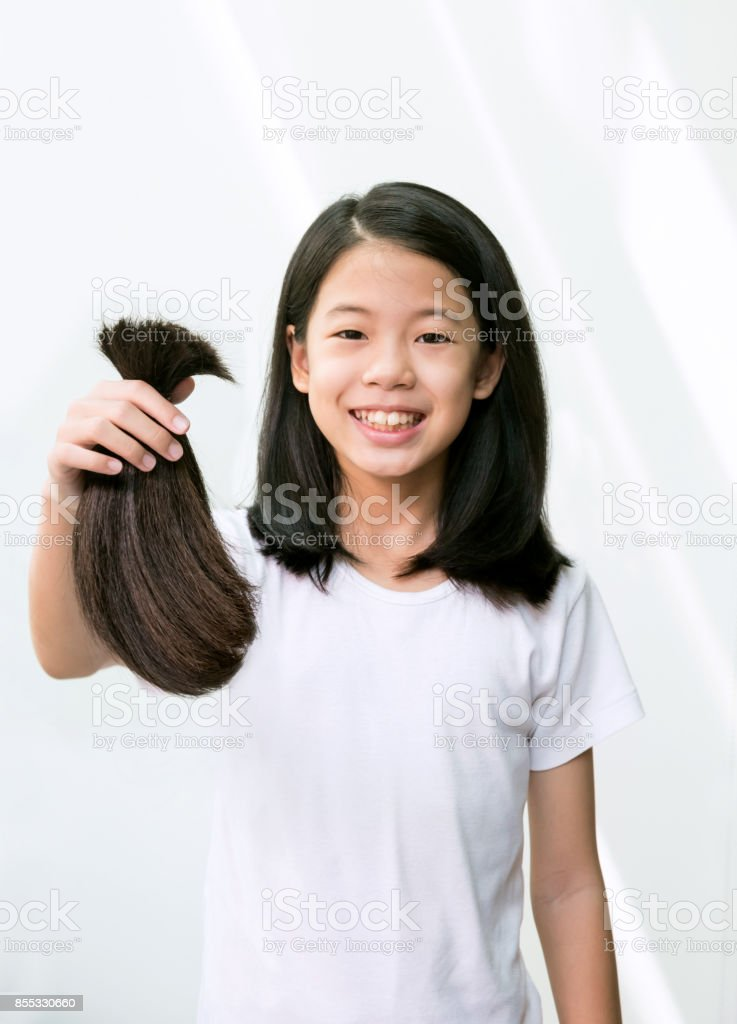 Teenage Girl Donating Her Healthy Hair To Cancer Patients Asian Kid