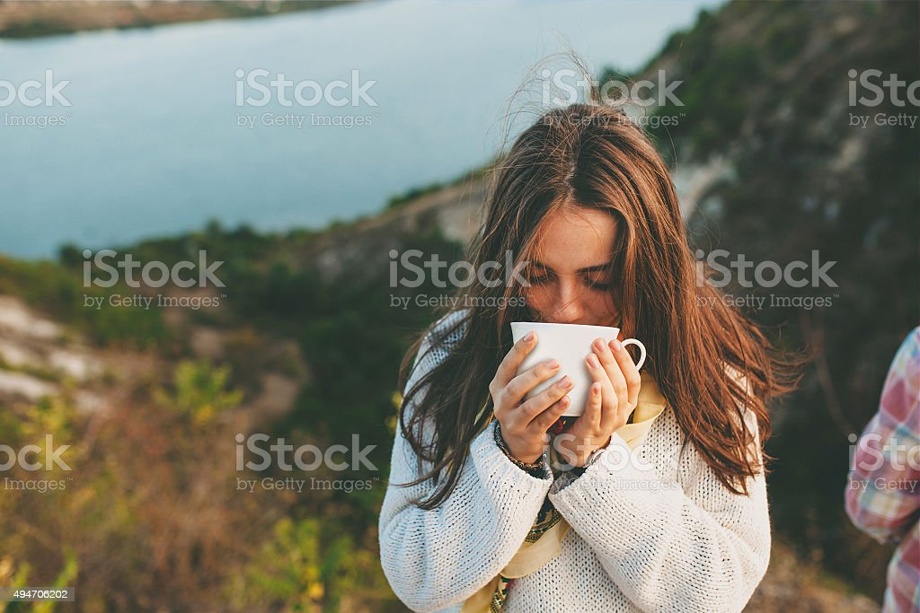 Teenage girl drinking coffee. stock photo
