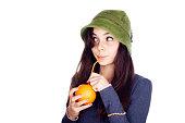 Teenage girl drinking orange juice.