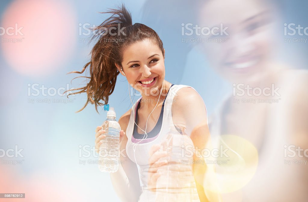 teenage girl drinking water. stock photo