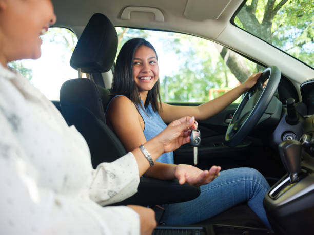 Teenage girl driving for the first time stock photo