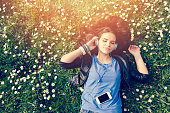 Girl lying down in the grass - copyspace