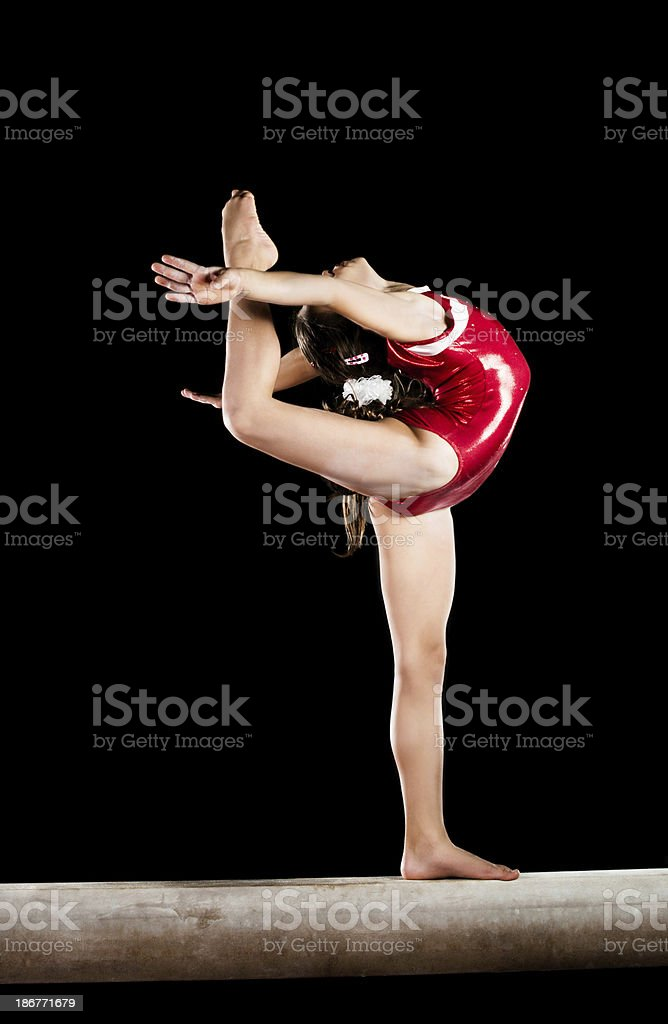 Teenage girl exercising on balance beam. royalty-free stock photo