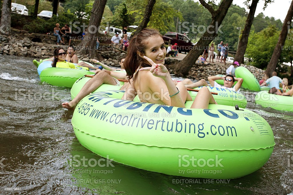 Teenage Girl Flashes Peace Sign While Tubing Down Georgia River royalty-free stock photo