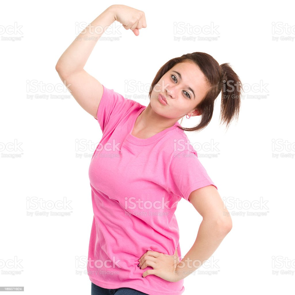 Teenage Girl Flexing Arm royalty-free stock photo