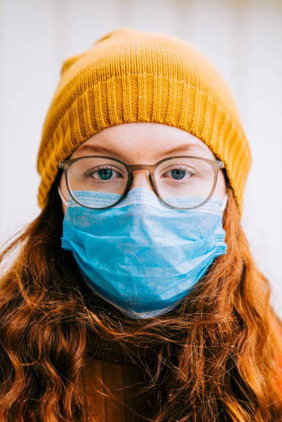Teenage girl going to school in time of pandemic disease Teenage girl wearing protective mask preparing for school during medical crisis of epidemic virus spreading covid 19 flatten the curve stock pictures, royalty-free photos & images
