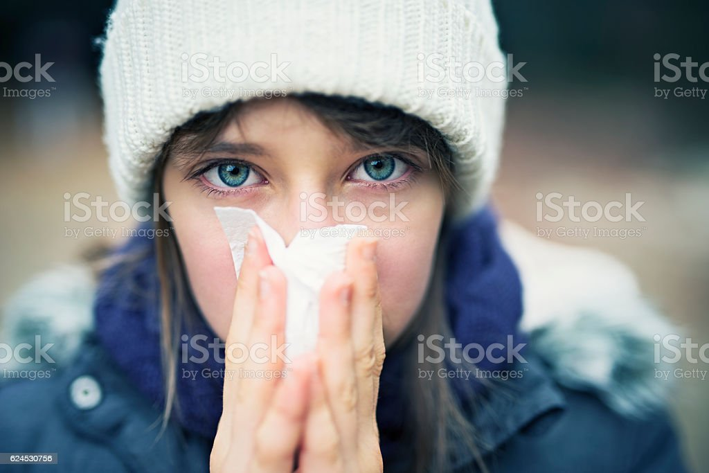 Teenage girl having autumn cold stock photo