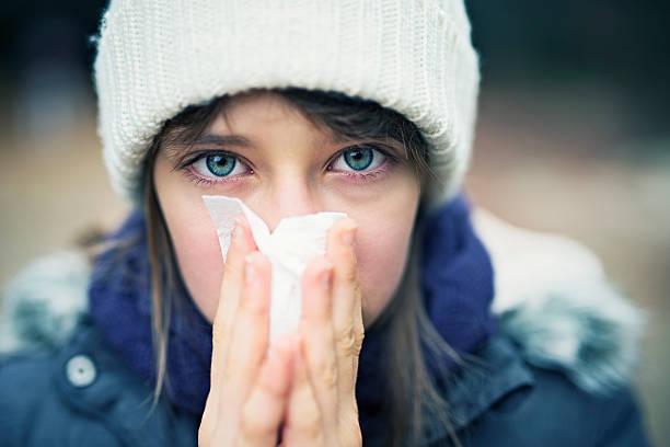 Teenage girl having autumn cold stock photo