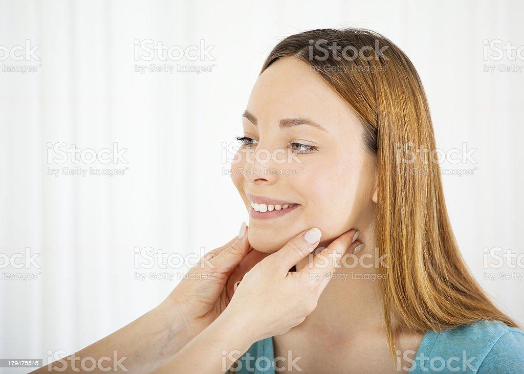 Teenage Girl Having Glands Exam. stock photo