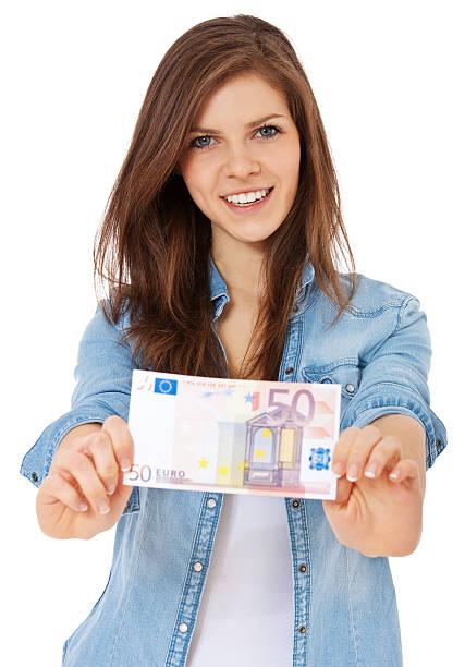 Teenage girl holding 50 euro note stock photo