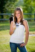 Teenage Girl Holding a Baseball Bat and Glove