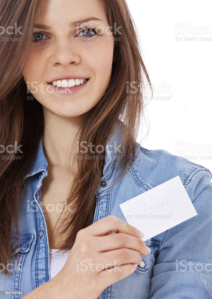 Teenage girl holding blank calling card royalty-free stock photo