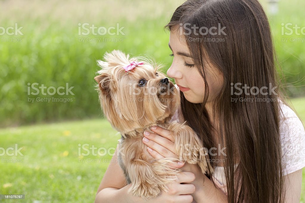 Teenage girl holding her Yorkshire Terrier dog stock photo