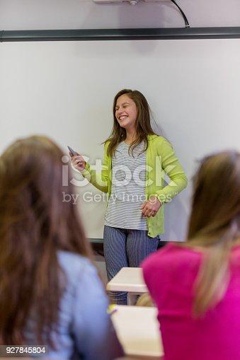 istock Teenage girl holding presentation 927845804