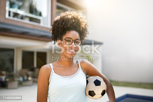Teenage holding soccer ball