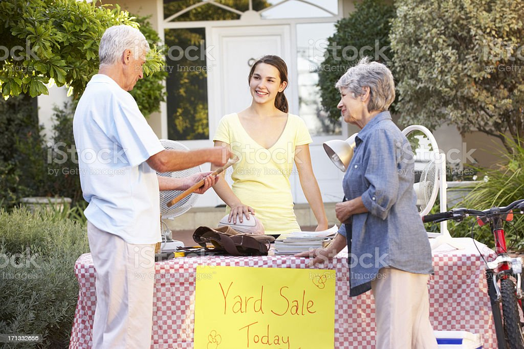 Teenage Girl Holding Yard Sale stock photo