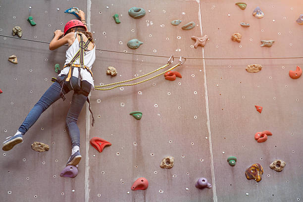 teenage girl in a free climbing wall teenage girl in a free climbing wall hobbies stock pictures, royalty-free photos & images