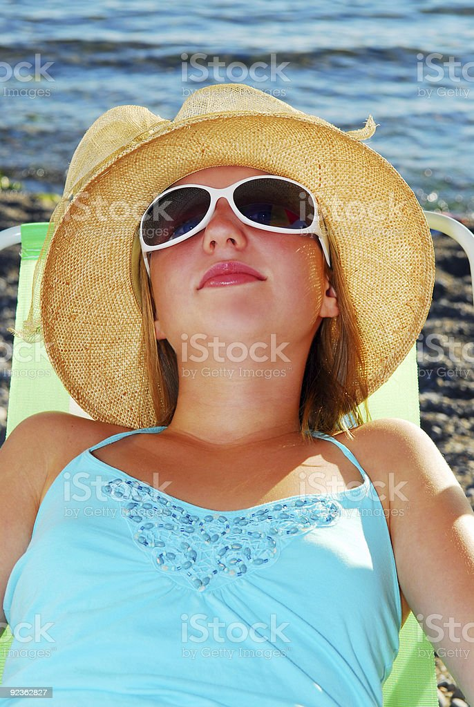 Teenage girl in a hat royalty-free stock photo