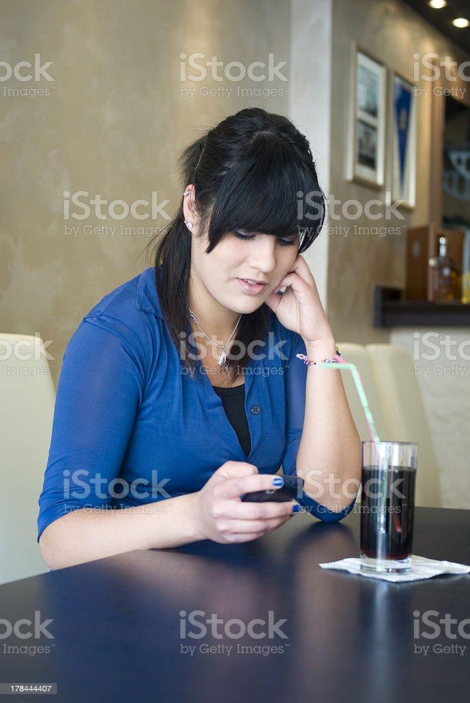 Teenage girl in bar stock photo