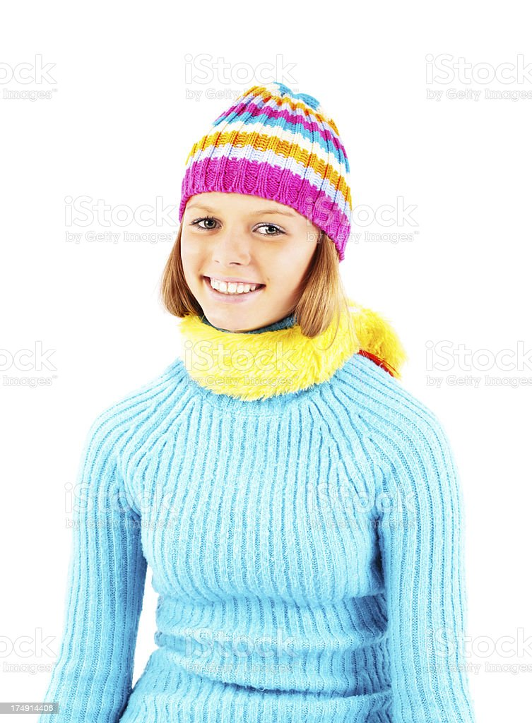Teenage girl in blue cardigan is looking at camera royalty-free stock photo