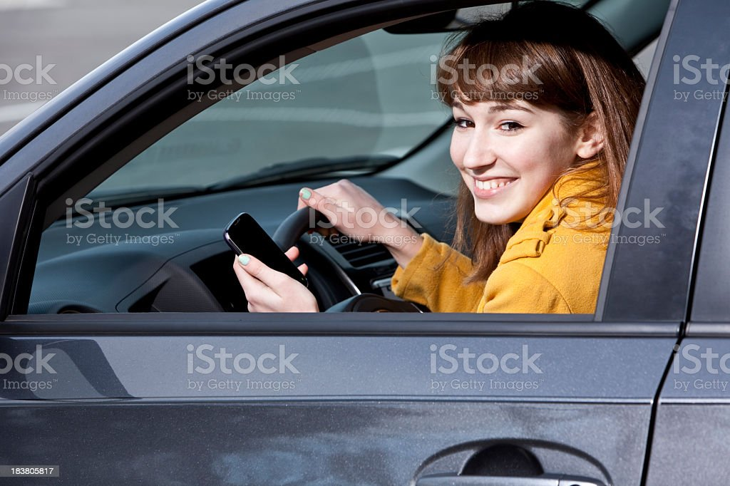 Teenage girl in car with mobile phone royalty-free stock photo