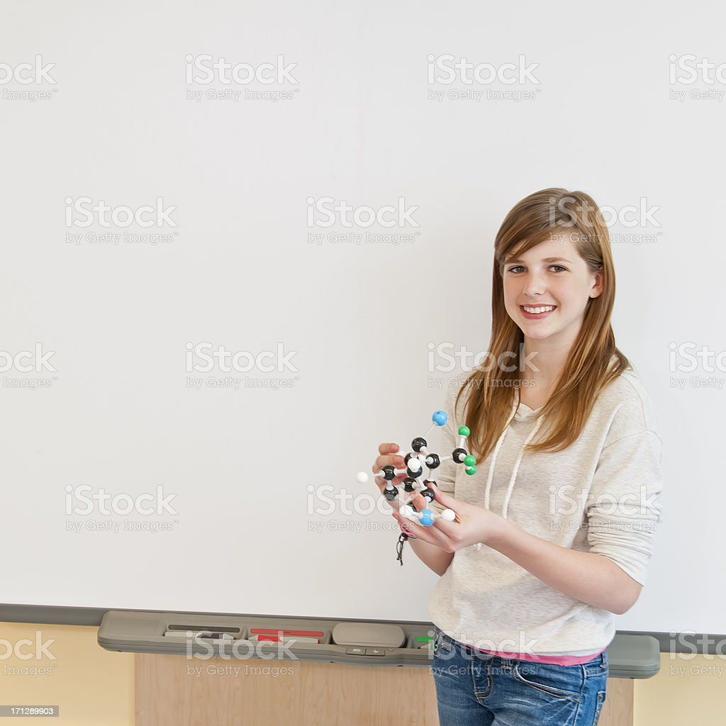 Teenage girl in contemporary science lab with chemistry models (VIII) royalty-free stock photo