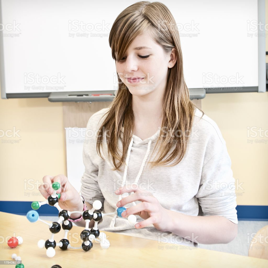 Teenage girl in contemporary science lab with chemistry models (I) royalty-free stock photo