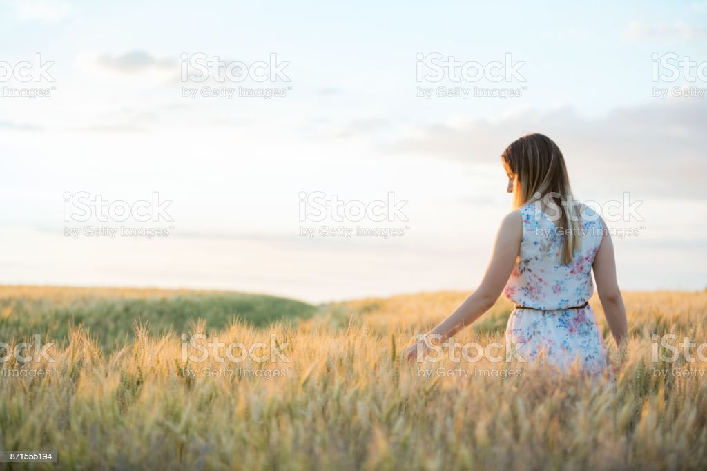 Teenage girl in field stock photo