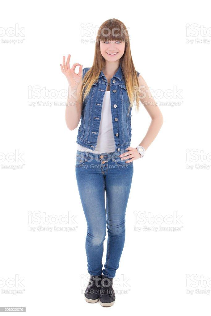 1a4acc862a adolescentes chica en pantalones vaqueros mostrando Vale ropa de señal foto  de stock libre de derechos