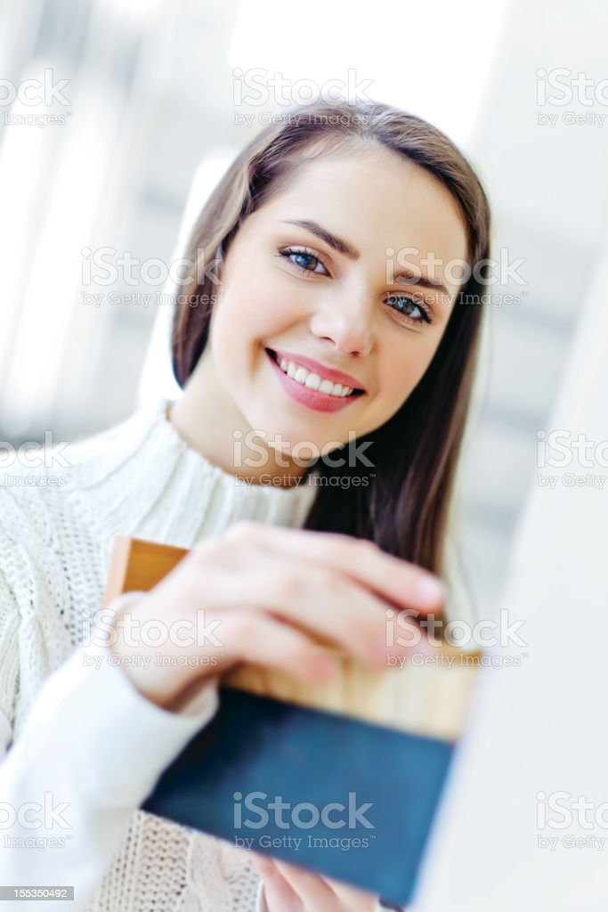 Teenage girl in library royalty-free stock photo