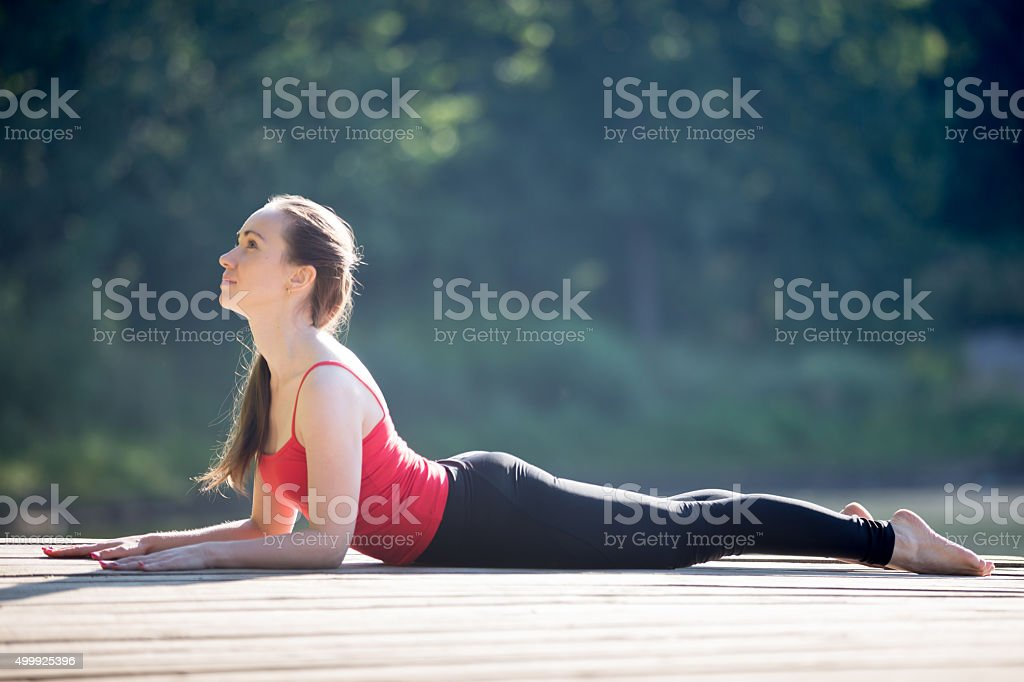 Teenage girl in Sphinx yoga Pose stock photo