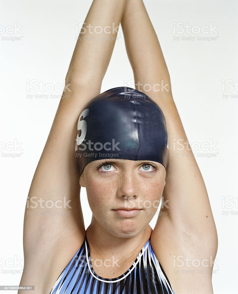 Teenage girl (13-14) in swimwear, looking up, smiling royalty-free stock photo