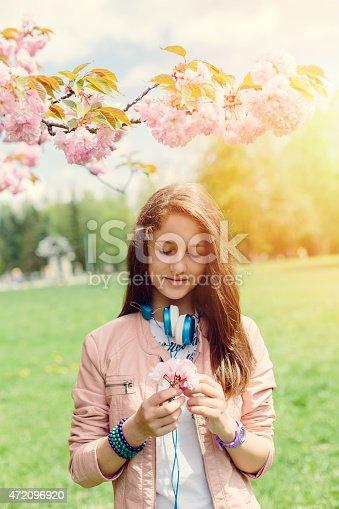 623358818 istock photo Teenage girl in the park 472096920