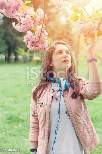 623358818 istock photo Teenage girl in the park 472353844