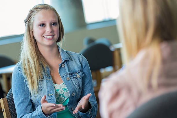 teenage girl in therapy session - teen counseling stock photos and pictures
