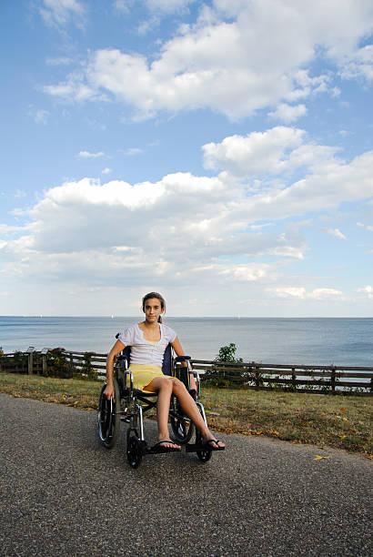 Teenage Girl in Wheelchair stock photo