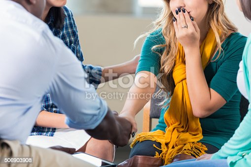 istock Teenage girl is comforted in group therapy 506903908