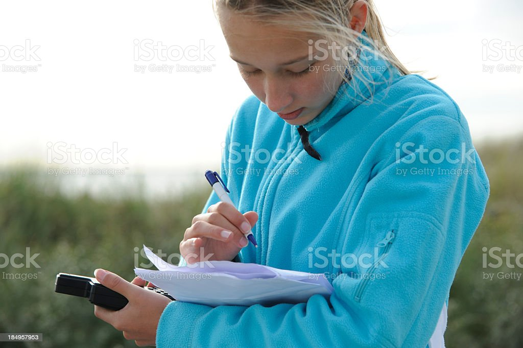 Teenage girl is writing stock photo