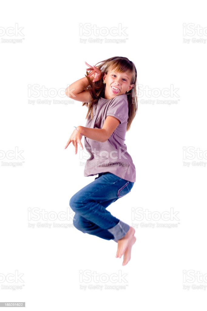 Teenage girl jumping in the air on white background stock photo