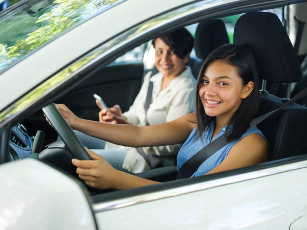 Teenage girl learning how to drive stock photo