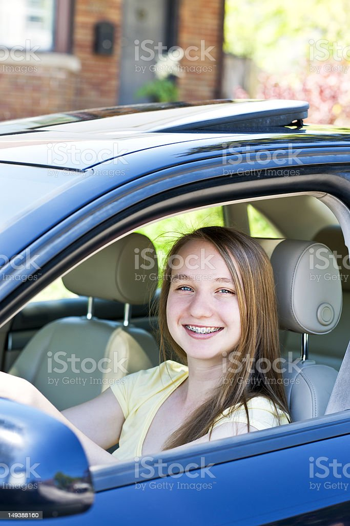 Teenage girl learning to drive royalty-free stock photo