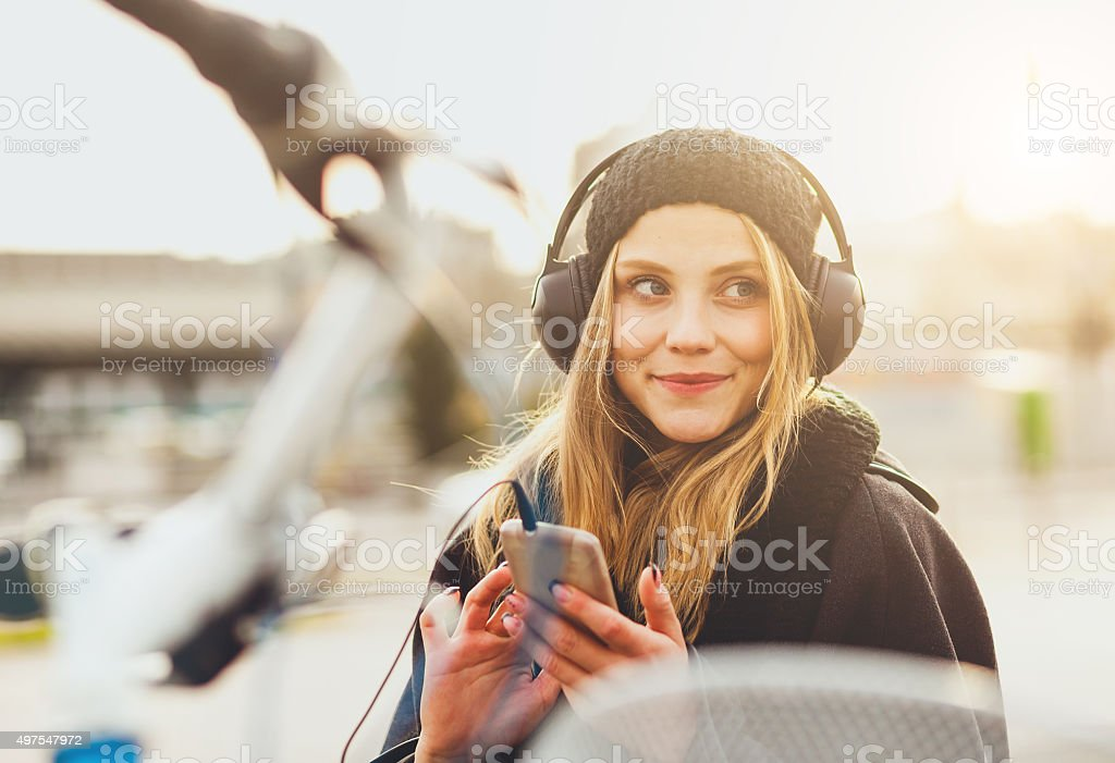 Teenage girl listening music with smartphone stock photo