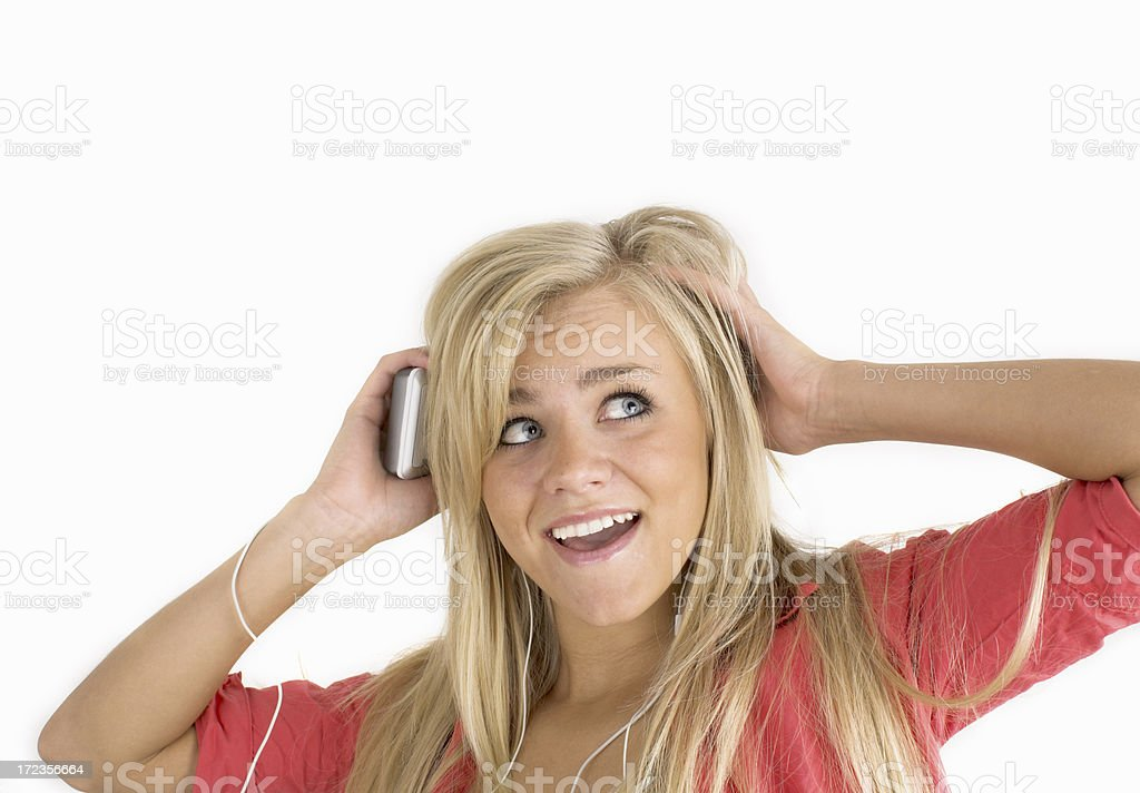 A teenage girl listening to music royalty-free stock photo