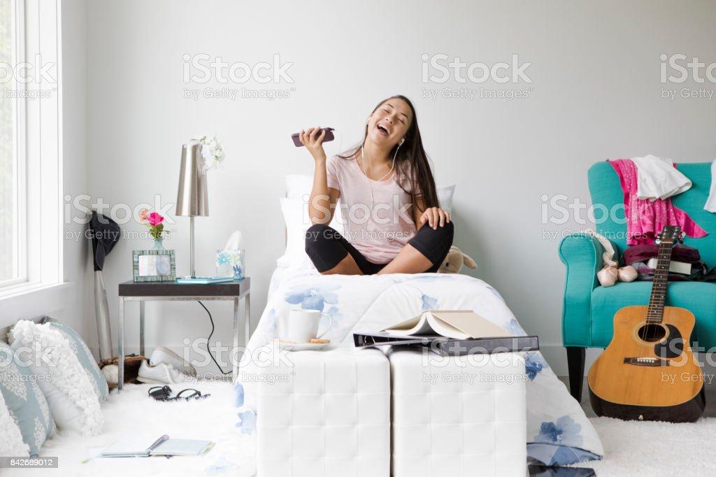 Teenage Girl Listening to Music stock photo