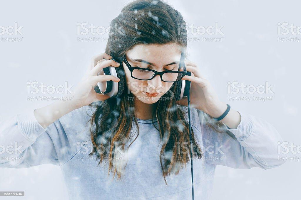Teenage Girl listening to music with headphones stock photo