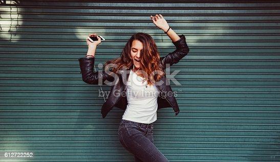 istock Teenage girl listening to the music 612722252