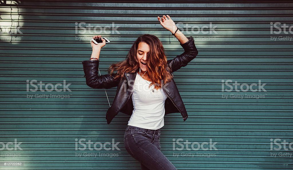 Teenage girl listening to the music stock photo