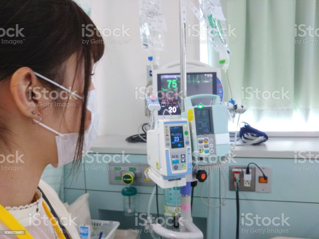 Teenage girl looking at medical equipment in a intensive care unit....